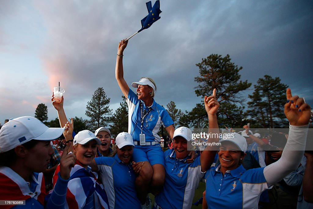 Members of the European Team hold Captain Liselotte Neumann on their shoulders as they celebrate defeating the United States 18-10 in the 2013 Solheim Cup on August 18, 2013 at The Colorado Golf Club in Parker, Colorado.