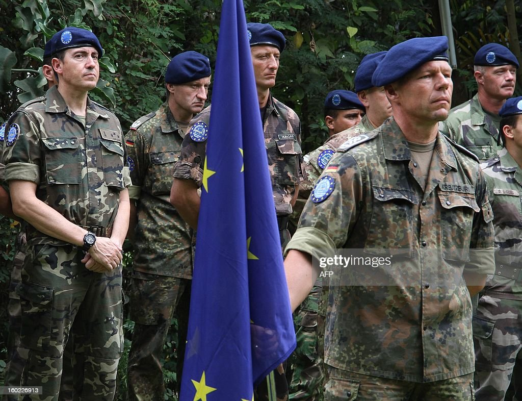 Members of the European Union Training Mission stand on parade at the European Union Training Mission Headquarters in Kampala on January 28, 2013. The EU will start specialized training of Somali army officers in Uganda. The EU has been training soldiers in Uganda since 2010 with some 3000 Somalis already trained in the facility. AFP PHOTO/ ISAAC KASAMANI