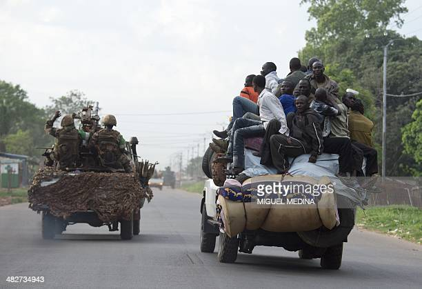 Members of the exSeleka rebels drive near a convoy of Chadian soldiers leaving Bangui escorted by the Africanled International Support Mission to the...