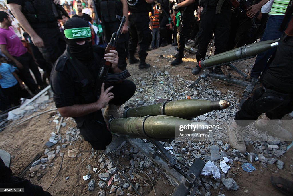Members of the Ezzeddin al-Qassam Brigades, the armed wing of Palestinian resistance faction Hamas, stand guard during their press statement in the Shujaya neighborhood in eastern Gaza City, Gaza on August 27, 2014.