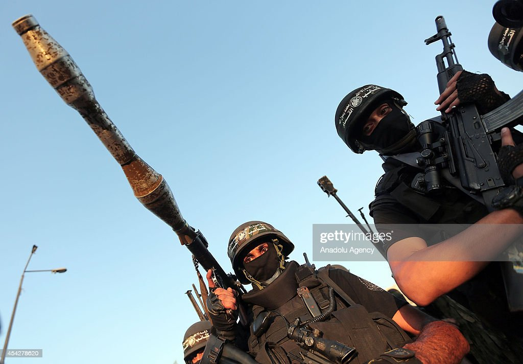 Members of the Ezzeddin al-Qassam Brigades, the armed wing of Palestinian resistance faction Hamas, stand guard during their press statement in the Shujaya neighborhood in eastern Gaza City on August 27, 2014.
