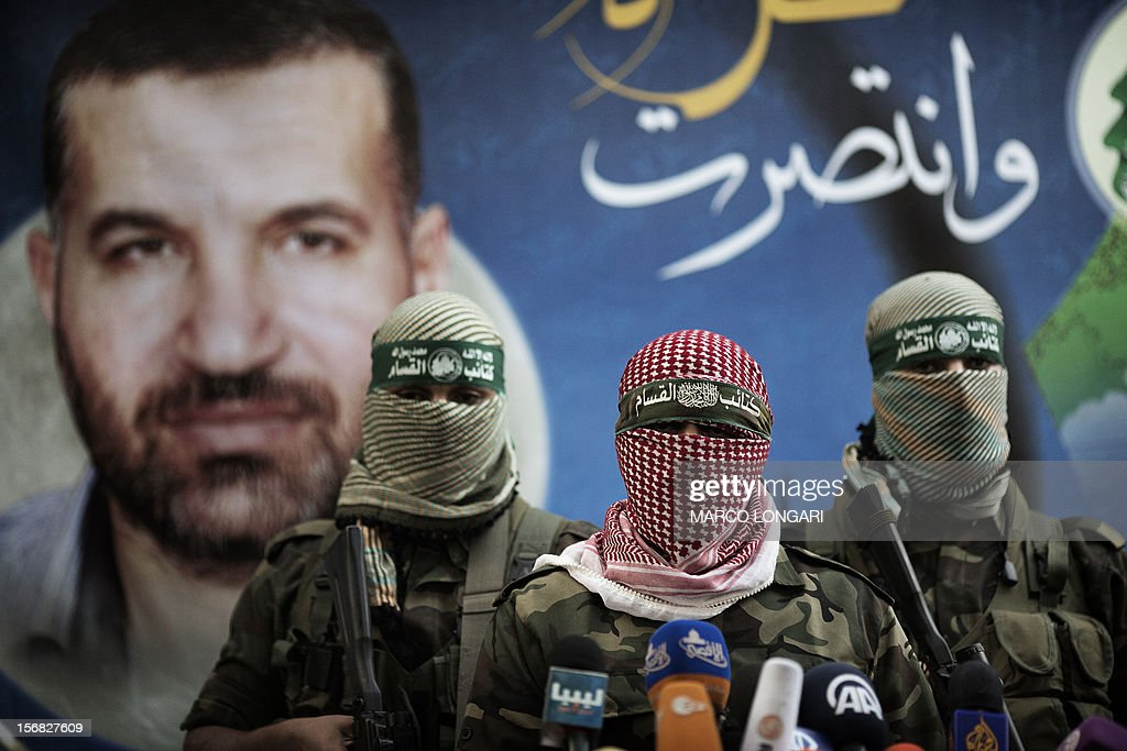 Members of the Ezzedine al-Qassam Brigades, the armed wing of Hamas, address a press conference in Gaza City on November 22, 2012 at the house of their late leader Ahmed Jaabari, who was killed when an Israeli air strike hit his car on November 14. Israeli politicians returned to the campaign trail as the streets of Gaza came back to life after a truce ended eight days of bloodshed, with both sides claiming victory while remaining wary.