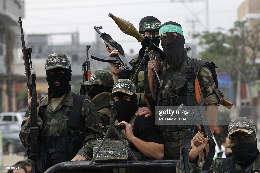 Members of the Ezzedine al-Qassam brigades, the armed wing of Hamas, carry their weapons as they celebrate after the truce between Gaza and Israel came into effect, in the Nusseirat refugee camp in the centre of the Gaza Strip, on November 22, 2012. An Egypt-brokered truce took hold in the Gaza Strip after a week of bitter fighting between militant groups and Israel, with both sides claiming victory but remaining wary.