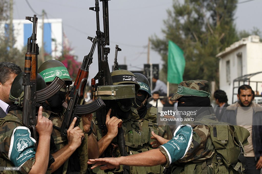 Members of the Ezzedine al-Qassam brigades, the armed wing of Hamas, attend the funeral of their comrade Nidal Hassan, killed the previous day, in the Nusseirat refugee camp in the centre of the Gaza Strip, on November 22, 2012. An Egypt-brokered truce took hold in the Gaza Strip after a week of bitter fighting between militant groups and Israel, with both sides claiming victory but remaining wary.