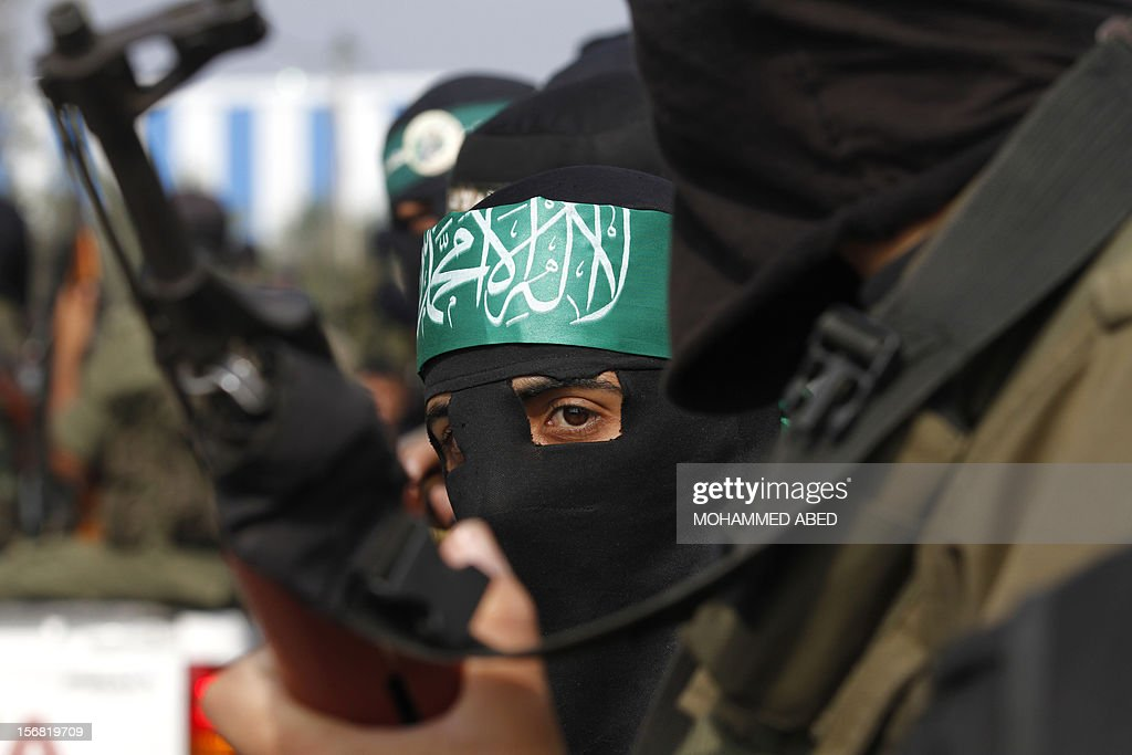 Members of the Ezzedine al-Qassam brigades, the armed wing of Hamas, attend the funeral of their comrad Nodal Hasan, in Nusseirat refugee camp, central of Gaza Strip, on November 22, 2012, after he was killed the previous day in an Isareli shelling. An Egypt-brokered truce took hold in the Gaza Strip after a week of bitter fighting between militant groups and Israel, with both sides claiming victory but remaining wary. AFP PHOTO/MOHAMMED ABED