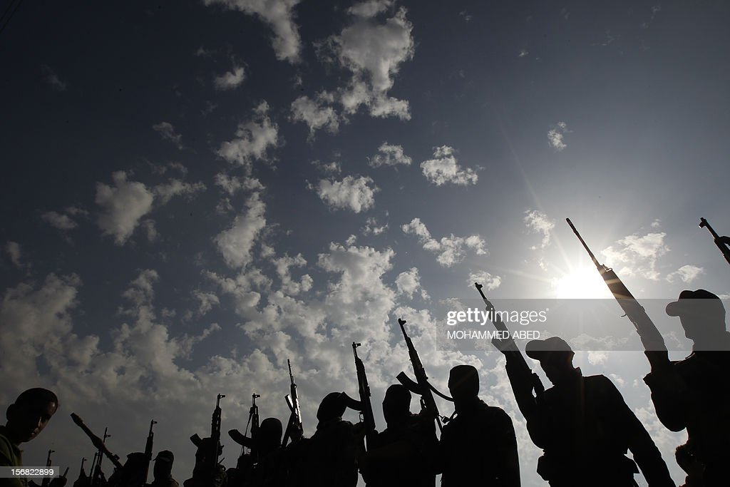 Members of the Ezzedine al-Qassam brigades, the armed wing of Hamas, attend the funeral of theircomrade Nidal Hasan, killed the previous day, in the Nusseirat refugee camp in the centre of the Gaza Strip, on November 22, 2012. An Egypt-brokered truce took hold in the Gaza Strip after a week of bitter fighting between militant groups and Israel, with both sides claiming victory but remaining wary.
