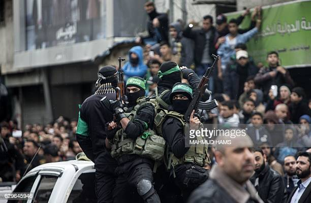TOPSHOT Members of the Ezzedine alQassam Brigades the military wing of the Palestinian Islamist movement Hamas take part in a rally marking the 29th...