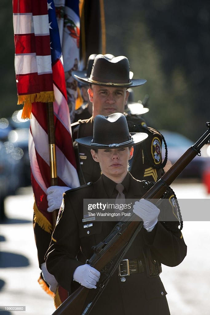 Members of the Fairfax County Police Honor Guard pass the entrance of Hylton Memorial Chapel during the funeral service for Prince William Police Officer Chris Yung on Friday, January 4, 2013.