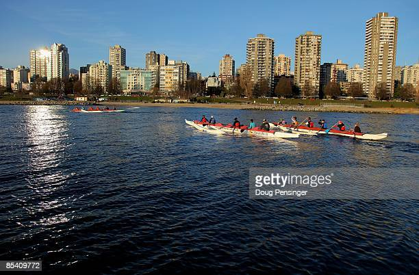 Members of the False Creek Racing Canoe Club paddle False Creek from the Burrard Civic Marina with the Vancouver city skyline as a backdrop on March...