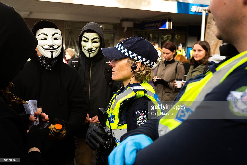 Members of the far left ANTIFA are spoken to by members of Victorian Police on May 28, 2016 in Melbourne, Australia. Violence erupted when participants in a 'Say No To Racism' rally protesting the forced closure of Aboriginal communities, off-shore detention centres and Islamophobia met with a counter 'Anti-Islam' rally organised by the True Blue Crew and backed by the United Patriots Front.