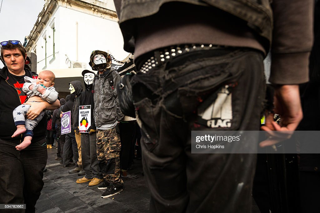Members of the far left ANTIFA form a line blocking Coburg mall on May 28, 2016 in Melbourne, Australia. Violence erupted when participants in a 'Say No To Racism' rally protesting the forced closure of Aboriginal communities, off-shore detention centres and Islamophobia met with a counter 'Anti-Islam' rally organised by the True Blue Crew and backed by the United Patriots Front.