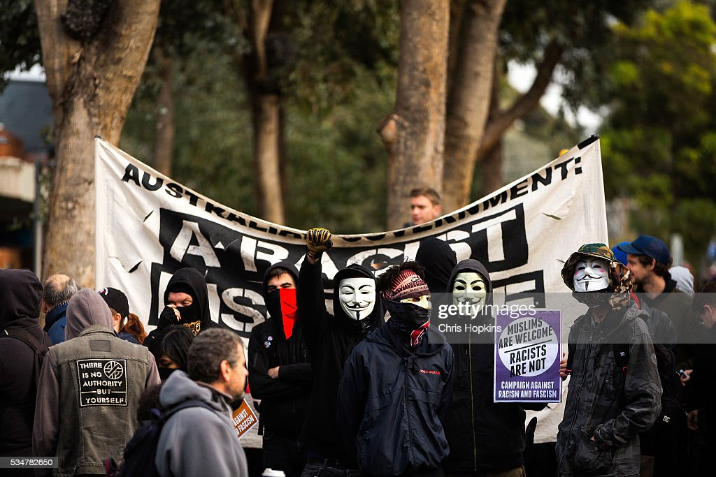 Members of the far left ANTIFA protest on May 28, 2016 in Melbourne, Australia. Violence erupted when participants in a 'Say No To Racism' rally protesting the forced closure of Aboriginal communities, off-shore detention centres and Islamophobia met with a counter 'Anti-Islam' rally organised by the True Blue Crew and backed by the United Patriots Front.