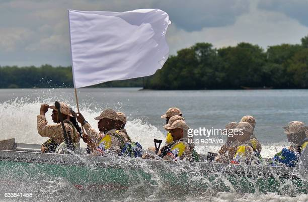 TOPSHOT Members of the FARC guerrilla with a white flag arrive in Buenaventura Colombia on February 4 from where they will go Sunday to UNmonitored...