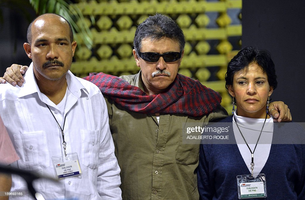 Members of the FARC-EP leftist guerrillas delegation commander Jesus Santrich (C), Maritza Garcia (R) and Emerio Gomez (L) , arrive at the Convention Palace in Havana for the peace talks with the Colombian government, on January 18, 2013.
