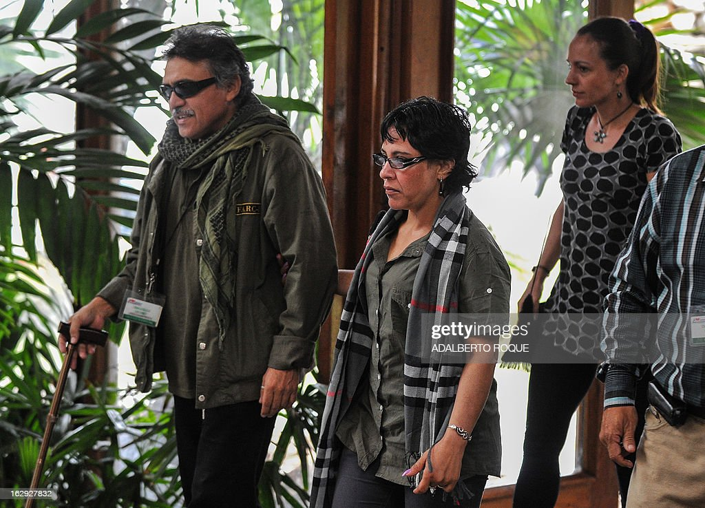 Members of the FARC-EP leftist guerrillas delegation (from L to R) Commander Jesus Santrich, guerrilla fighter Maritza Garcia and Dutch guerrilla fighter Tanja Nijmeijer, arrive at the Convention Palace in Havana to deliver a press conference on March 1, 2013. AFP PHOTO/ADALBERTO ROQUE