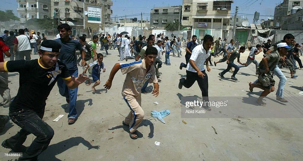 Members of the Fatah movement run during clashes with the Hamas Executive police forces August 31 2007 in Gaza City Gaza Strip Hamas policemen...