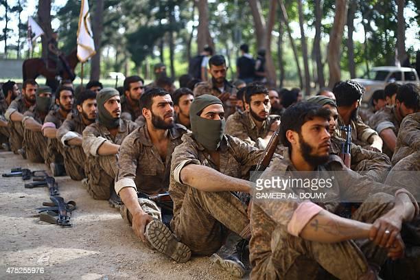 Members of the Faylaq alRahman brigade take part in a military parade on May 30 in Syria's rebelheld Eastern Ghouta region AFP PHOTO / SAMEER ALDOUMY