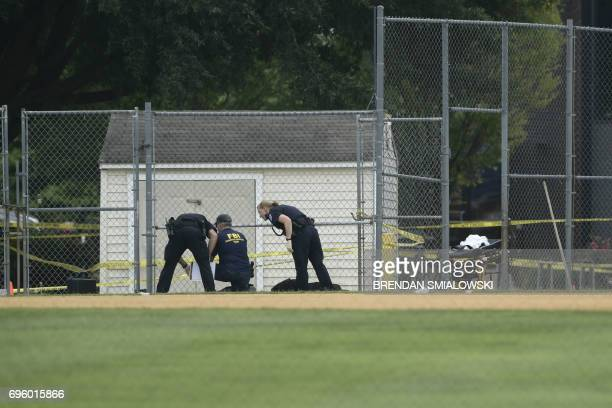 Members of the FBI and other law enforcement inspect the crime scene after a shooting during a practice of the Republican congressional baseball at...
