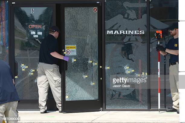 Members of the FBI Evidence Response Team gather information at Armed Forces Career Center/National Guard Recruitment Office on July 17 2015 in...