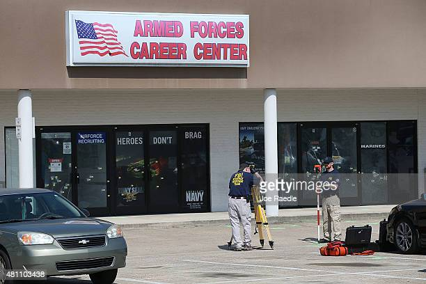 Members of the FBI Evidence Response Team investigate the shooting at the Armed Forces Career Center/National Guard Recruitment Office on July 17...
