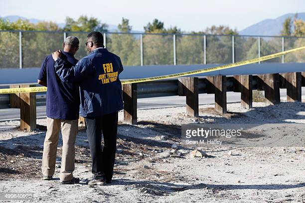 Members of the FBI Joint Terrorism Task Force stand outside of a press conference regarding the shooting that occurred at the Inland Regional Center...