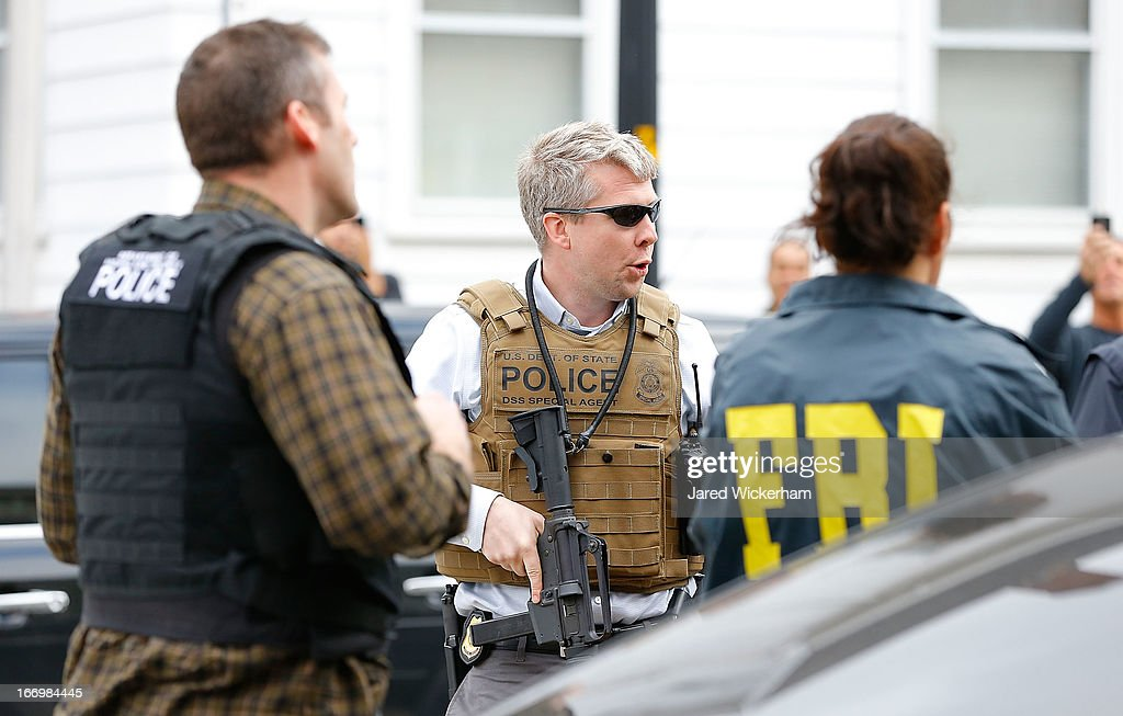 Members of the FBI, State Police, Boston Police, Cambridge Police, and other law enforcement agencies, survey the perimeter near the home of suspect #2 on Norfolk Street April 19, 2013 in Cambridge, Massachusetts. A Massachusetts Institute of Technology (MIT) campus police officer was shot and killed late Thursday night at the school's campus in Cambridge. A short time later, police reported exchanging gunfire with alleged carjackers in Watertown, a city near Cambridge. One suspect has been killed during the car chase and police are seeking another, believed to be the same person (known as Suspect Two) wanted in connection with the deadly bombing at the Boston Marathon earlier this week. Police have confirmed that the dead assailant is Suspect One from the recently released marathon bombing photographs.