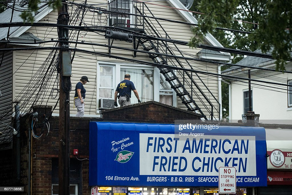 Members of the Federal Bureau of Investigation (FBI) and other law enforcement officials investigate a residence in connection to Saturday night's bombing in Manhattan, September 19, 2016 in Elizabeth, New Jersey. On Monday morning, law enforcement released a photograph of 28-year-old Ahmad Khan Rahami, who they are seeking in connection to the attack. First American Fried Chicken, on the ground floor of their home on Elmora Avenue, is owned by Rahami's father Muhammad Raham.