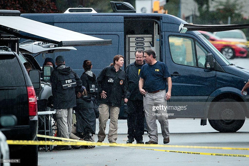 Members of the Federal Bureau of Investigation (FBI) work at the site where Ahmad Khan Rahami, who was wanted in connection to Saturday night's bombing in Manhattan, was arrested after a shootout with police, September 19, 2016 in Linden, New Jersey. On Monday morning, law enforcement released a photograph of 28-year-old Ahmad Khan Rahami, who they are seeking in connection to the attack.