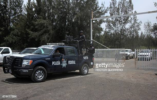 Members of the Federal police leave a ranch along the JaliscoMichoacan highway in Vista Hermosa Michoacan State on May 22 2015 where gunmen took...