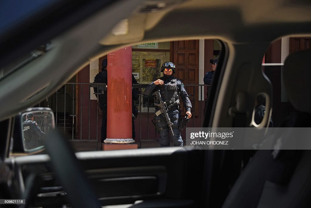 Members of the Federal Police patrol the streets of San Cristobal de las Casas, Chiapas State, Mexico on February 12, 2016. Pope Francis will arrive in Mexico on Friday, where he will visit until February 17. AFP PHOTO/Johan ORDONEZ / AFP / JOHAN ORDONEZ