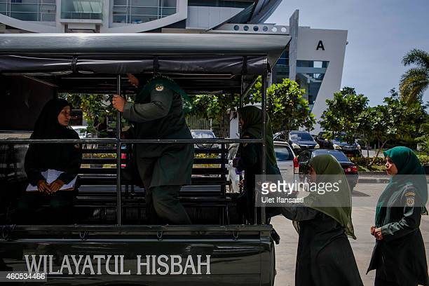 Members of the female sharia police known as Wilayatul Hisbah prepare for patrol on December 12 2014 in Banda Aceh Indonesia Aceh is the only...