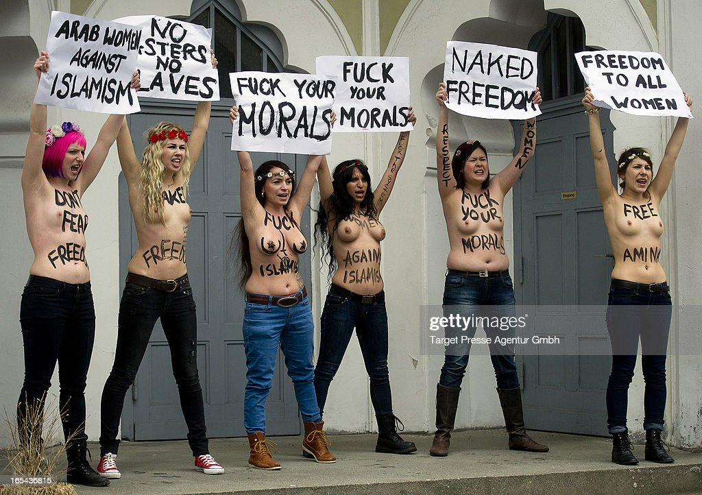 Members of the FEMEN activist group bear their breasts in protest at the Ahmadiyya-Moschee (Berlin`s oldest Mosque) on April 4, 2013 in Berlin, Germany. The women, under the slogan of 'International topless Jihad Day,' were protesting for the rights of Tunesian FEMEN activist Amina Tyler, who has received death threats since posting photographs of herself topless online.