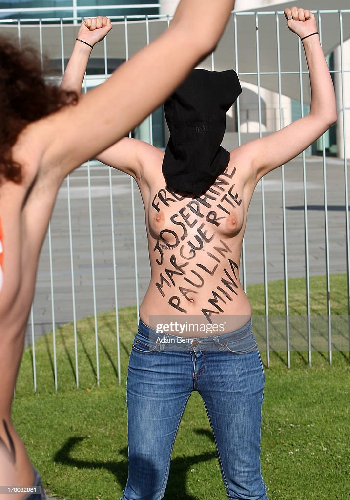 Members of the feminist Ukrainian protest group Femen demonstrate while chanting 'Merkel Free Femen!' in front of the German federal chancellery prior to the visit of Tunisian Prime Minister Ali Larayedh on June 7, 2013 in Berlin, Germany. The protesters were demonstrating in support of fellow Femen members Pauline Hillier and Marguerite Stern of France and Josephine Markmann of Germany, on trial for holding a topless anti-Islamist protest in Tunisia last week, where they face a possible six-month prison sentence if they are convicted. The group primarily focuses on protesting against dictatorship, religion, and the sex industry, and its demonstration on May 29 outside the main courthouse in Tunis was its first topless one in the Arab world.