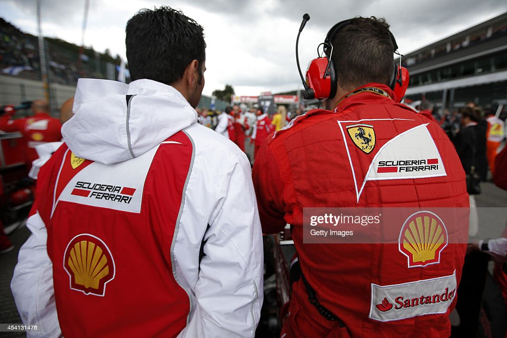 Members of the Ferrari team prepare on the grid before the Belgian Grand Prix at Circuit de Spa-Francorchamps on August 24, 2014 in Spa, Belgium.