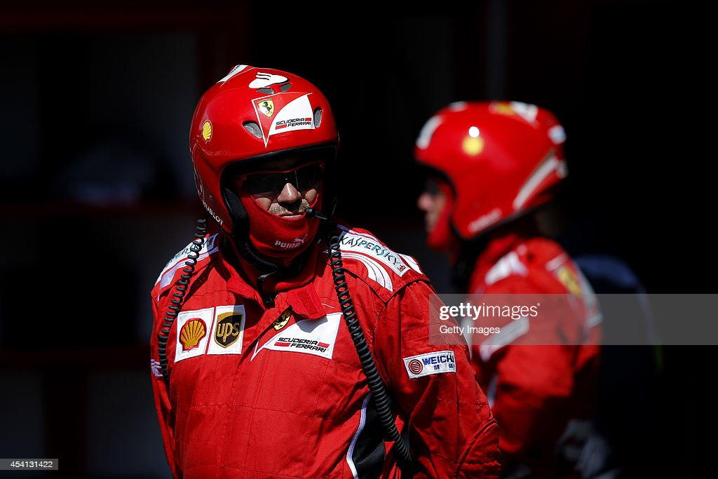 Members of the Ferrari team wait in between pit stops during the Belgian Grand Prix at Circuit de Spa-Francorchamps on August 24, 2014 in Spa, Belgium.