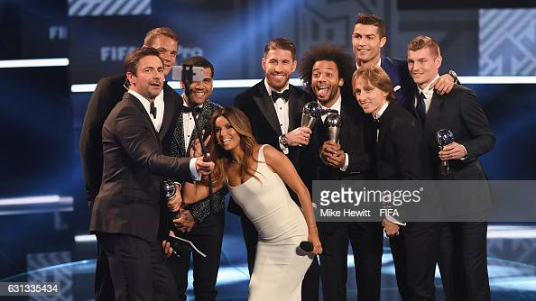 Members of the FIFA FIFPro World11 pose on stage with hosts Eva Longoria and Marco Schreyl during The Best FIFA Football Awards at TPC Studio on...