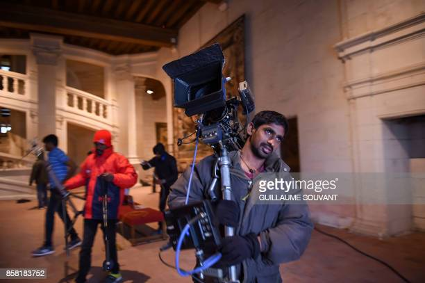 Members of the film crew work in the Chateau of Chambord during the shooting of the Indian action film 'Junga' on October 5 2017 The film in Tamil...