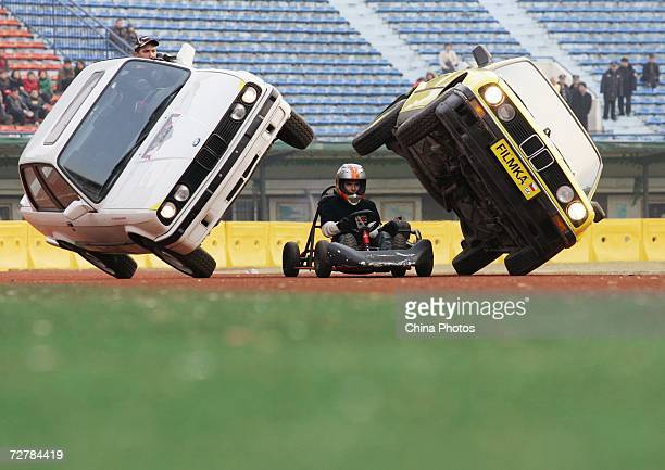 Members of the Filmka Stunt Team based in Hollywood perform car stunts at a stunt show December 9 2006 in Wuhan of Hubei Province China The Filmka...