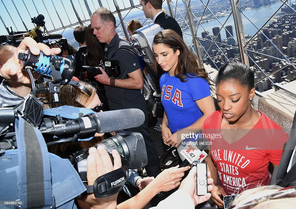 Members of the 'Final Five' US Women's Gymnastics Olympic Team Aly Raisman and Simone Biles visit the Empire State Building in New York on August 23...