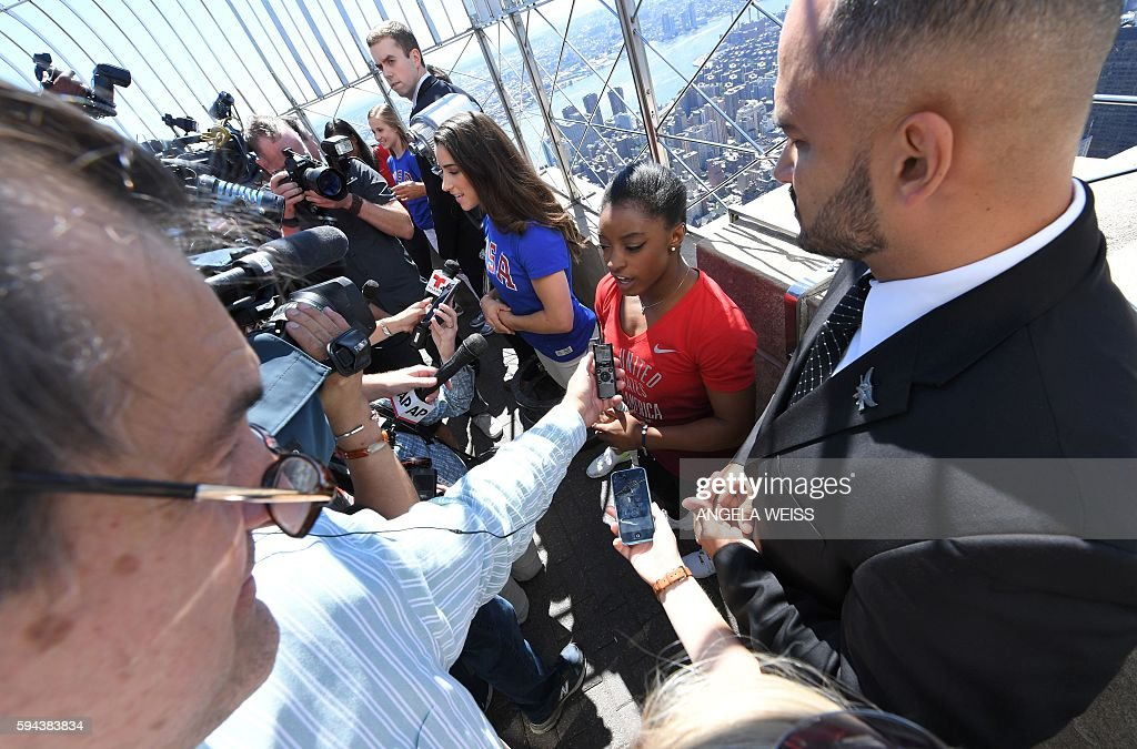 Members of the 'Final Five' US Women's Gymnastics Olympic Team Aly Raisman and Simone Bilesspeak to the media as they visit the Empire State Building...