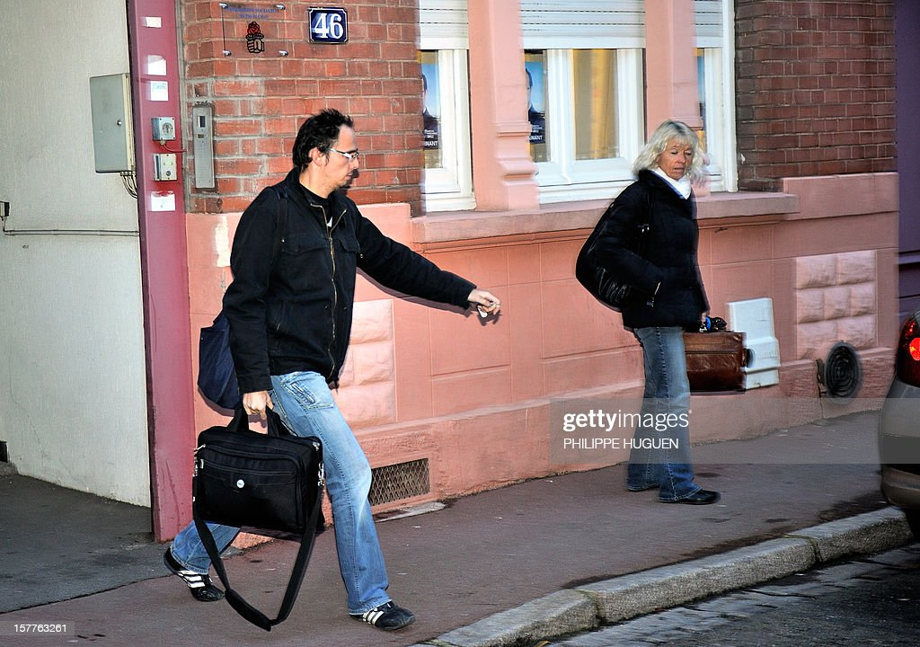 Members of the Financial police leave the headquarters of the French socialist party federation of the Pas-de-Calais, on December 6, 2012 in Lens, after a search as part of an inquiry into an alleged hidden financing of this federation, involving local MP Jean-Pierre Kucheida.