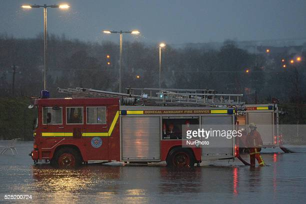 Members of the fire brigade in action in Ballybofey as the storm Desmond hit West and North of Ireland with heavy rain and strong winds causing roads...