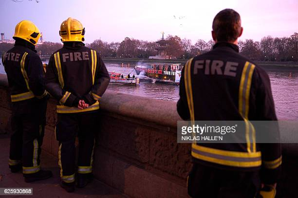 Members of the fire serivce on a fire boat extinguish the flames set by son of Vivienne Westwood and Sex Pistols creator Malcolm McLaren Joe Corre...