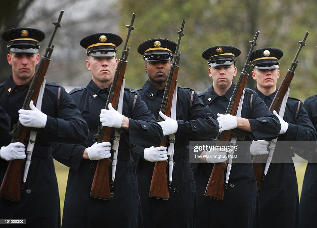 Members of the firing party fire three volleys during the burial service for U.S. Army Sgt. Aaron X. Wittman at Arlington National Cemetery on Friday, February 8, 2013. 28, Sgt. Wittman was supporting Operation Enduring Freedom at the time of his death. He was the first combat KIA of 2013. Sgt. Wittman is from Chester, VA.