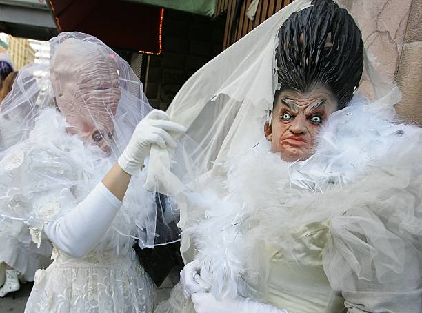 Members of the flash mob group calling themselves the 'Brides of March' fix their