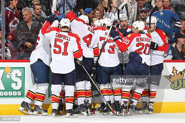 Members of the Florida Panthers celebrate an overtime win against the Colorado Avalanche at the Pepsi Center on October 21 2014 in Denver Colorado...