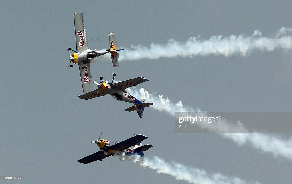 Members of The Flying Bulls aerobatics team from the Czech Republic fly in formation in their Zlin Z-50's during the second day of the ongoing 9th Edition of Aero India Show 2013 in Bangalore on February 7, 2013. India, the world's leading importer of weaponry, is hosting one of Asia's biggest aviation trade shows with Western suppliers eyeing lucrative deals and a Chinese delegation attending for the first time.