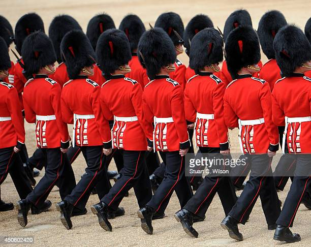 Members of the Foot Guards march past Queen Elizabeth II military dignitary and members of the public during Trooping the Colour at The Royal...