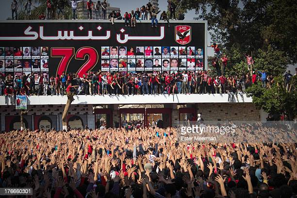 CONTENT] Members of the football club Al Ahly also known as the Ultras celebrate the second verdict in the case of the Port Said massacre at the Al...