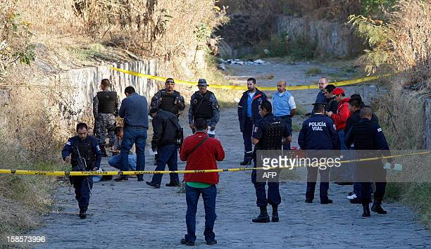 Members of the forensic service and the municipal police investigate the crime scene where the body of Venezuelan model Daisy Yenire Ferrer was found...